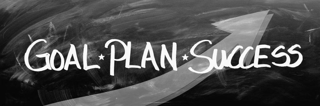 "The words ""goal, plan, success"" written on a black board"
