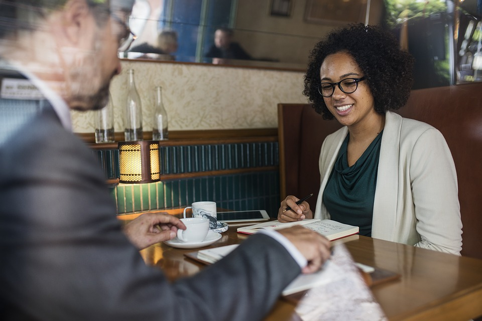 Woman consulting with businessman