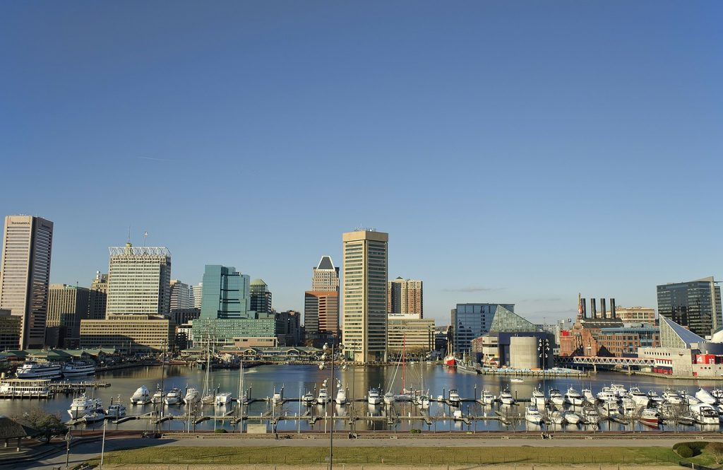Baltimore harbor, buildings, boats, water and a clear sky