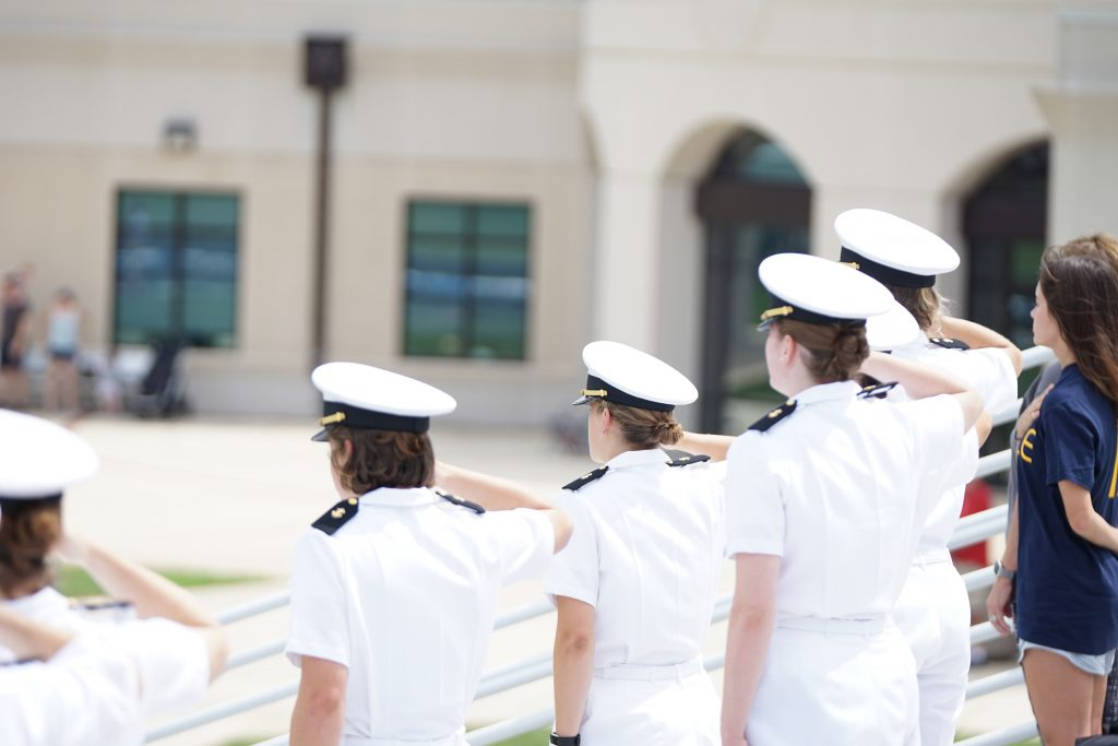 Navy recruits saluting