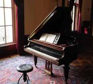 Grand piano, red kilim