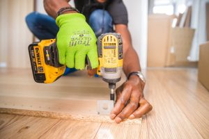 worker disasembling furniture