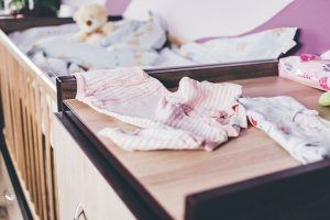 Baby clothes on a dresser
