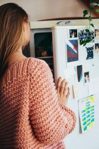 Girl looking into her fridge