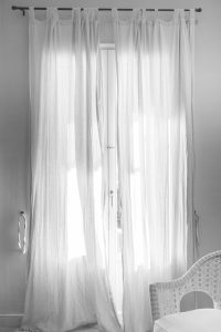 Introducing long curtains can help you make your home appear bigger