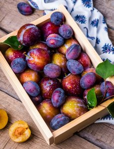 Plums in a crate
