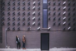 two women facing security camera