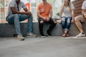 befriend your new neighbors after a move by talking to them while sitting on concrete bench