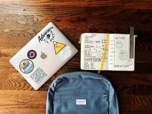a bag, laptop, and a notebook
