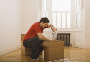 Man unpacking boxes