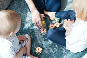 organize a stress-free move with kids by playing with your kids
