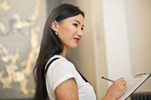 A woman making a checklist