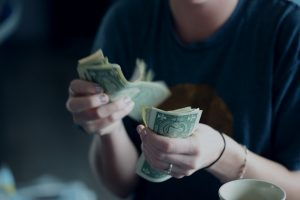 woman counting dollars