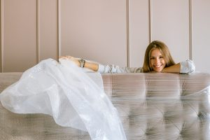 woman smiling behind a couch