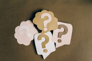 cut-outs in the shape of question marks