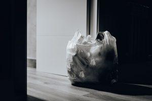 A trash bag near the door