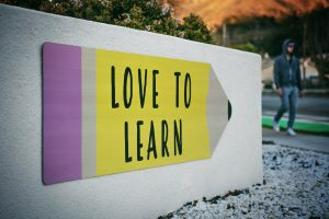 love to learn written on a wall