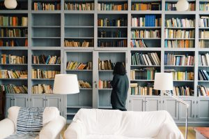 woman looking at the bookshelves