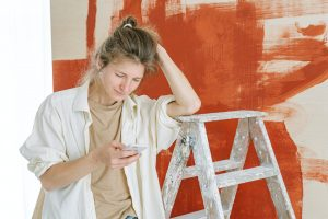 Woman painting her walls