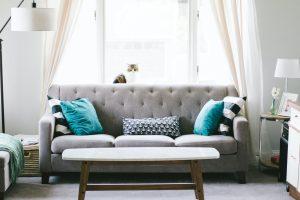 grey sofa with blue pillows