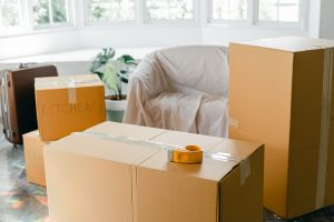 a couple of boxes with labels in the living room as part of downsizing tips for senior couples