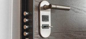 a picture of black reinforced door as one of the home security hacks you should consider after moving house
