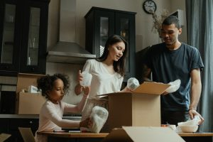 A family unpacking in their new home