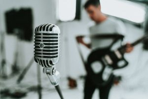 Microphone with an artist unfocused in the background