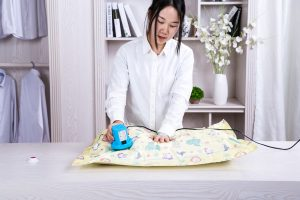 a woman using vacuum bags to create more space in your new home