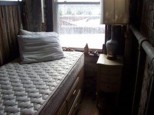 A bed beside a window