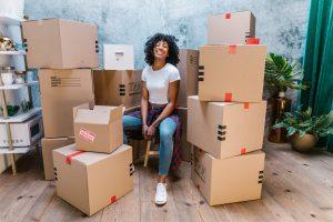 Girl sitting around moving boxes