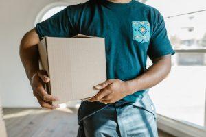 A mover handling a box
