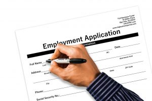 a person filing in a job application