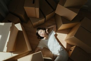 a person among cardboard boxes