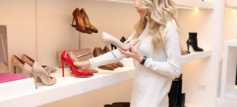 woman choosing the shoes