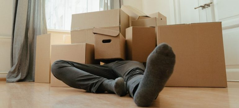 Manlaying among the moving boxes