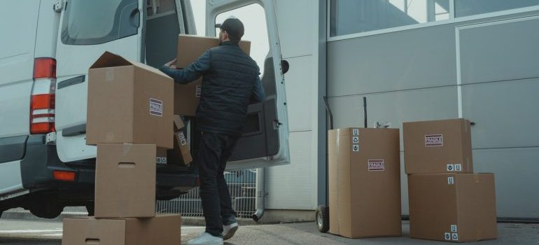 Man loading boxes in a van