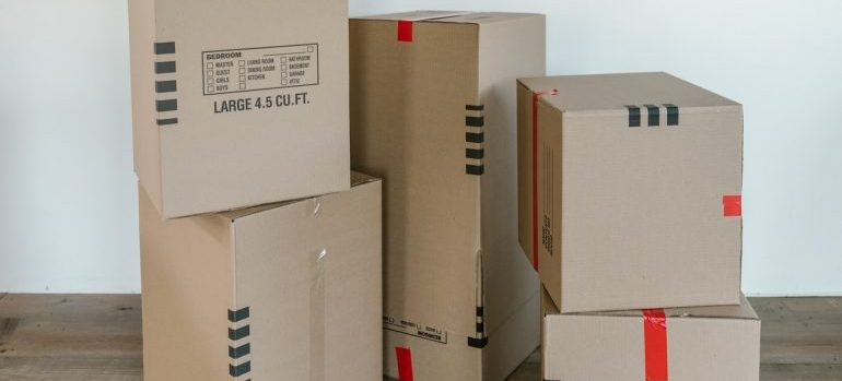 Boxes of different sizes on the floor